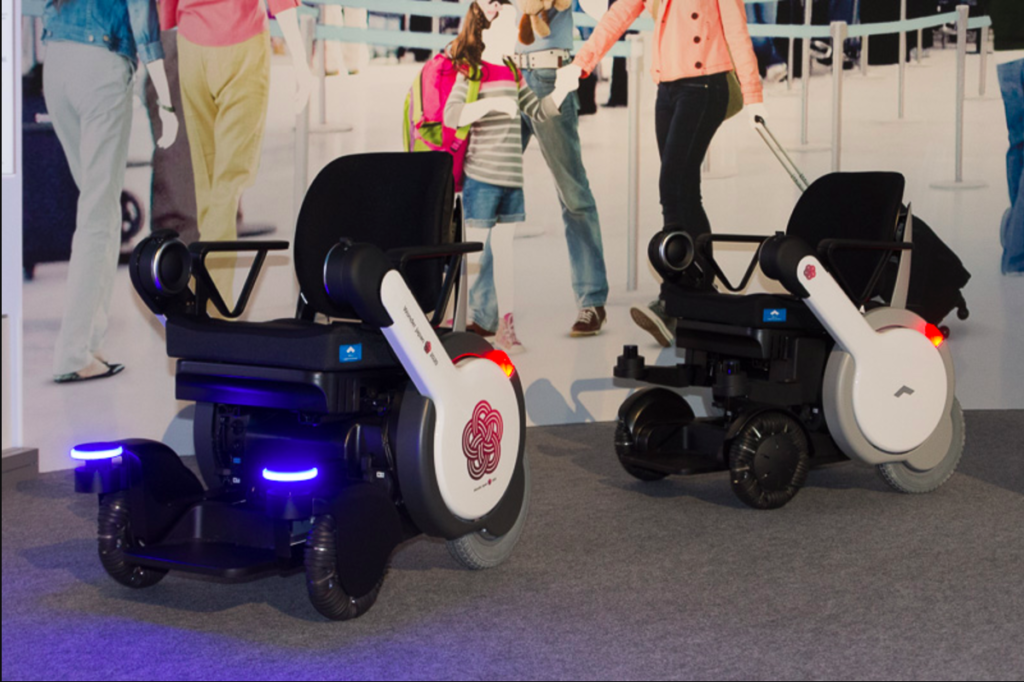 Panasonic / Tokyo Haneda Airport / WHILL INC working together on WHILL NEXT automated robotic electric wheelchairs for improved accessibilities and passenger experience